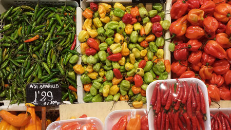 cayenne: different types of chilli peppers on mexican market.