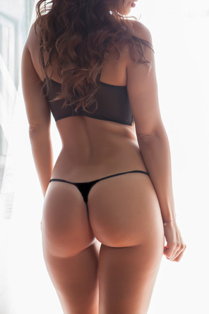 thong woman: sensual and beautiful young woman back with lingerie