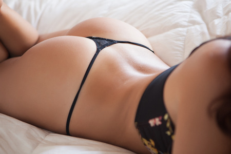 woman back with sensual lingerie in black color