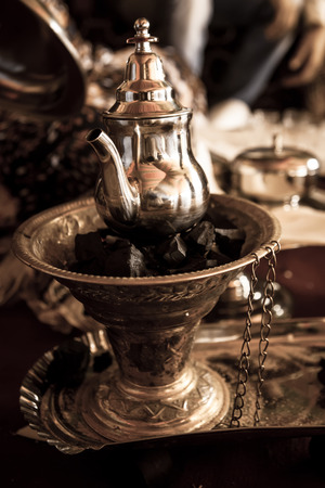 party tray: preparing and serving morocco tea in traditional glasses
