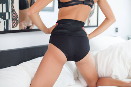 black ass: young woman back and ass in black lingerie Stock Photo