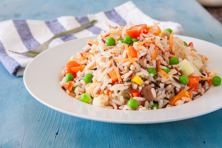 wild rice: fresh rice salad with vegetables on white bowl
