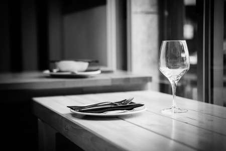 emulation: artistic black and white with noise emulation of dish and cup on restaurant Stock Photo