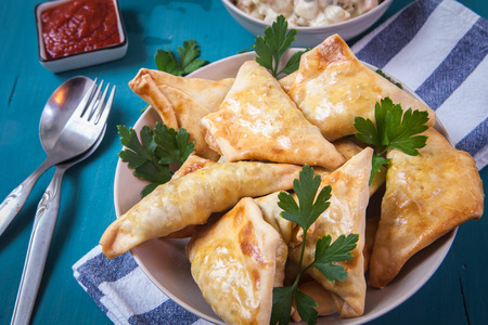 samosa: indian samosa filled with chicken curry on tray
