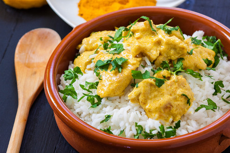 chicken rice: chicken curry with boiled rice and spices