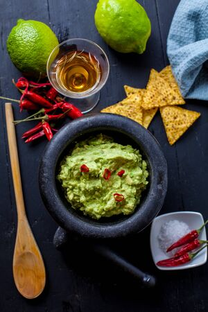 stone bowl: black stone bowl with fresh guacamole and nachos for dip