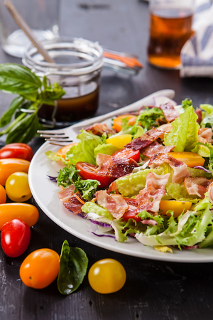 fresh salad with different lettuce types and tomatoes