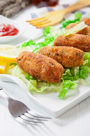 homemade chicken and vegetables croquettes on white tray