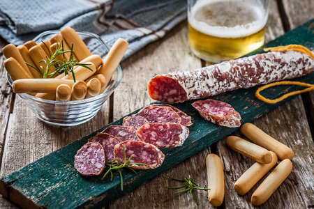 embutido: slices of spanish pork sausage on table with bread