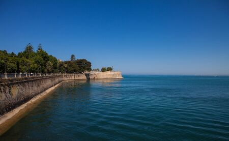 cadiz: the defense wall that surrounds the city of Cadiz in a blue sky day
