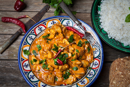 curry bowl: Chicken curry tikka masala with basmati rice on decorated bowl