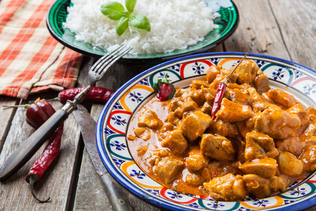 masala: Chicken curry tikka masala with basmati rice on decorated bowl