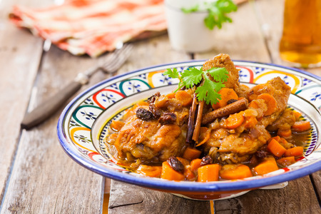 maroc: chicken with carrots and raisin maroc style on decorated bowl
