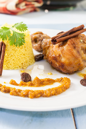 maroc: maroc style chicken with carrot sauce and cinnamon served with couscus Stock Photo