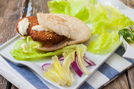 lebanese: pita bread with lebanese falafel and salad with sauce