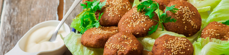 lebanese food: lebanese food with chickpeas deep fried falafel and salad with yougur sauce