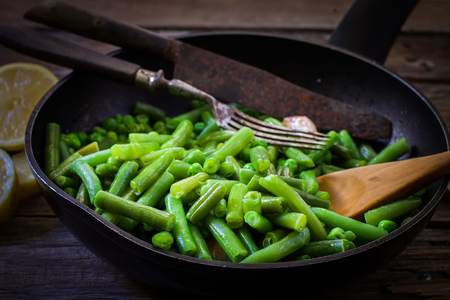 green vegetable: cooking fresh green beans on frying pan