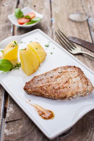 potato tuna: fresh tuna steak grilled served with potato and paprika sauce Stock Photo