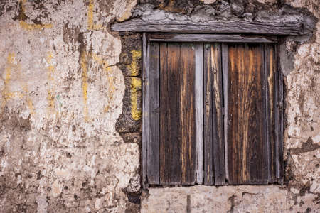 abandoned house window: vintage old wood window on dirty rock wall Stock Photo