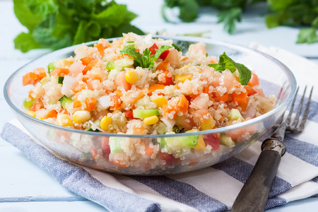 chickpea: fresh quinoa salad taboule style with vegetables on bowl Stock Photo