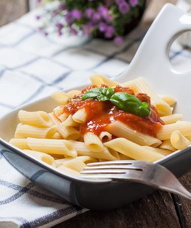 tomato sauce: macaroni pasta with tomato sauce and basil