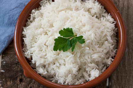 vegetable cook: basmati rice boiled served on pot with parsely