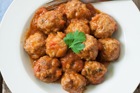 side of beef: beef meatballs on tomato sauce with rice for side