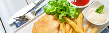 tenders: deep fried breaded chicken with salad and french fries