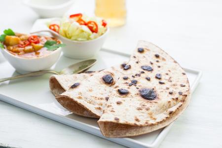 tandoori chicken: Indian tikka masala chicken and naan flat bread Stock Photo