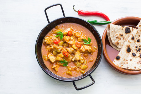 naan: Indian tikka masala chicken and naan flat bread Stock Photo