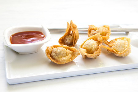 ton: deep fried won ton with sweet and sour sauce on tray Stock Photo