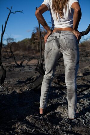 denim jeans: young woman with dirty sensual jeans in nature