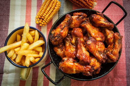 jerk: deep fried chicken leg with french fries Stock Photo