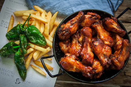 jerk: deep fried chicken leg with french fries and green peppers