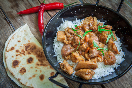 chicken curry with basmati rice on pot
