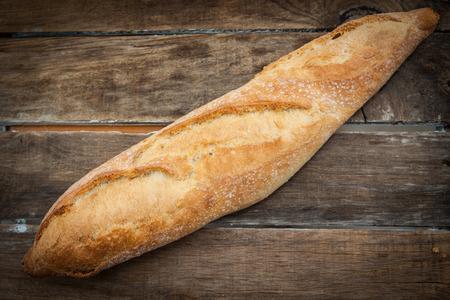 artisan bakery: homemade rustic farm bread on wood background