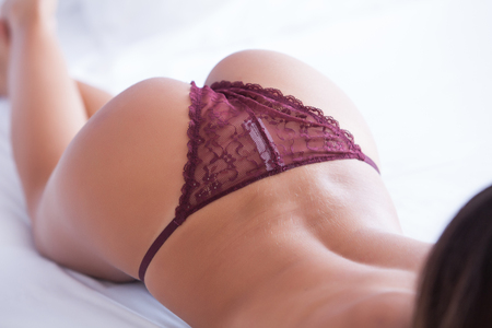woman ass and back with  lingerie on bed