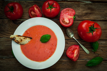 a platte of spanish cold tomato soup gazpacho