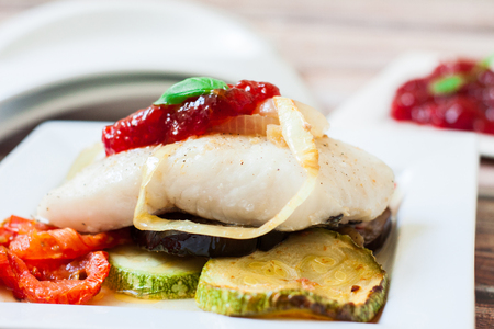 fresh cod roasted with sweet pepper jam 免版税图像