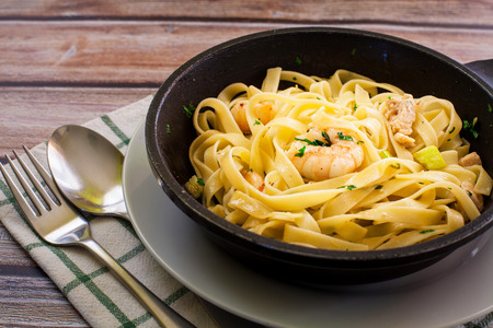 tagliatelle on white plate ready for eat Stock Photo