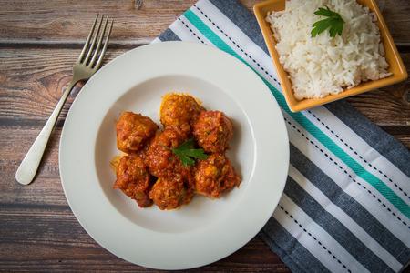 beef meatballs on tomato sauce served on plate 版權商用圖片