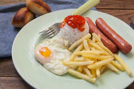 american breakfast with egg and sausage and rice Stock Photo