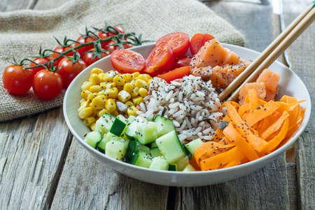 homemade fresh salmon poke with vegetables on bowl Stock Photo