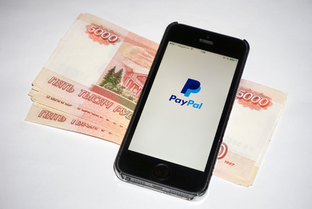 Samara, Russia - February 15, 2015: PayPal app open in the mobile phone Iphone 5s. Apple Corporation main direction rapidly developing market of smartphones. PayPal free application in app store