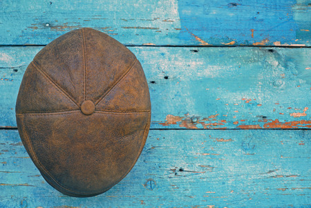 brown leather hat: leather brown hat on wooden background Stock Photo