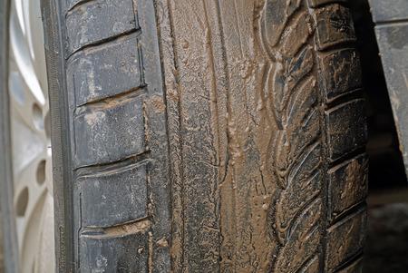 dirty car: Dirty wheel of the car Stock Photo