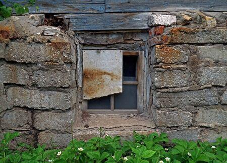 downtrodden: downtrodden window in old house