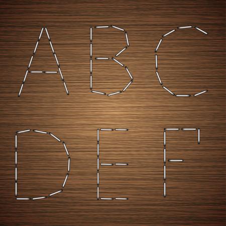 modern staples alphabet on wooden background