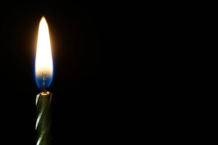 llamas de fuego: burning candle isolated on black with place for text Foto de archivo
