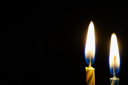 blue flame: burning candle isolated on black with place for text Stock Photo